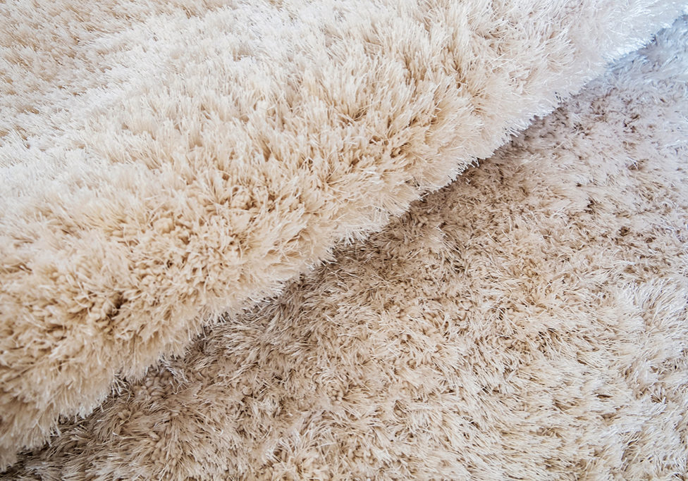 luxury bend beige carpet texture background